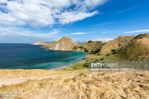scenic view of sea against sky - rinca island stock pictures, royalty-free photos & images