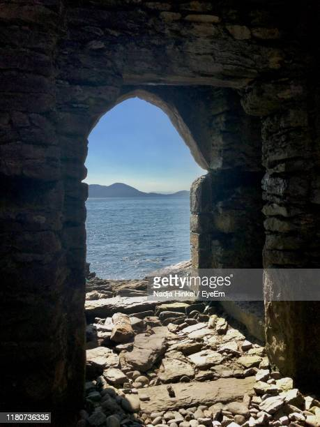 scenic view of sea against sky - arch stock pictures, royalty-free photos & images