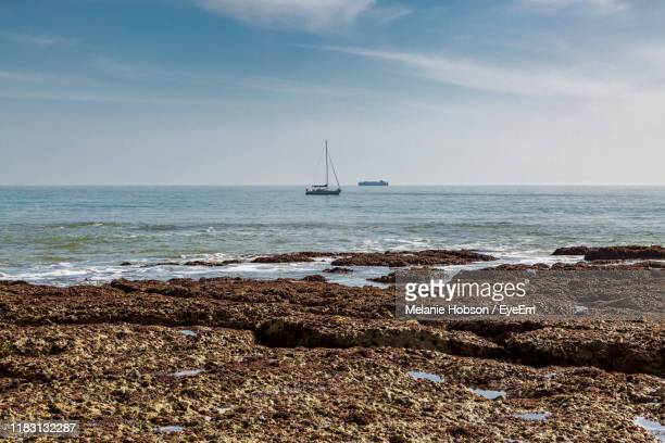 scenic view of sea against sky - freshwater bay isle of wight stock pictures, royalty-free photos & images