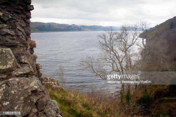scenic view of sea against sky - drumnadrochit stock pictures, royalty-free photos & images