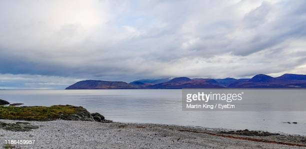 scenic view of sea against sky - water's edge stock pictures, royalty-free photos & images