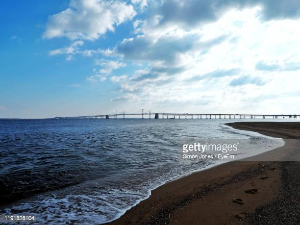 scenic view of sea against sky - bay bridge stock pictures, royalty-free photos & images