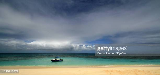 scenic view of sea against sky - emma hunter eye em stock photos and pictures