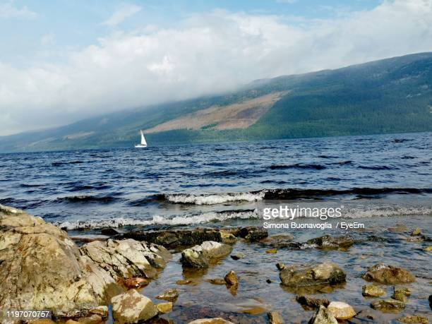 scenic view of sea against sky - loch ness stock pictures, royalty-free photos & images