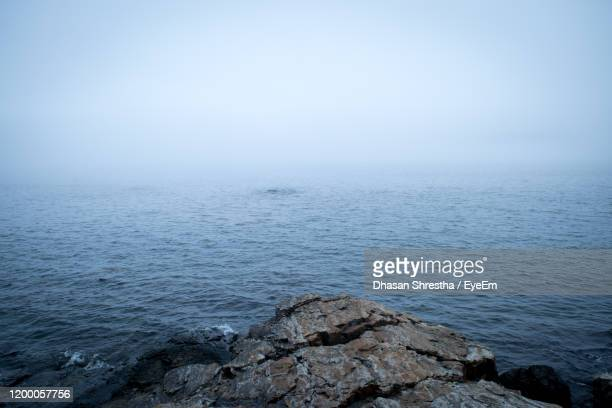 scenic view of sea against sky - cliff stock pictures, royalty-free photos & images