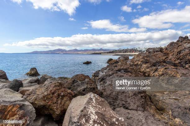 scenic view of sea against sky - puerto del carmen stock pictures, royalty-free photos & images