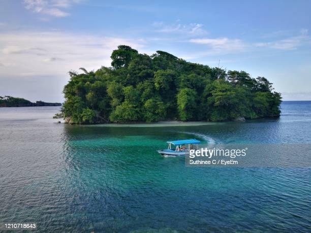 scenic view of sea against sky - jamaica stock pictures, royalty-free photos & images