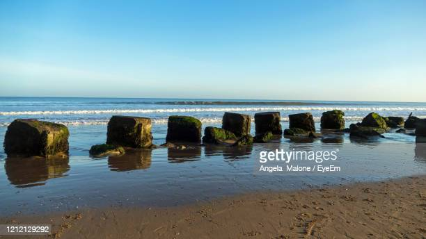 scenic view of sea against sky - bridlington stock pictures, royalty-free photos & images
