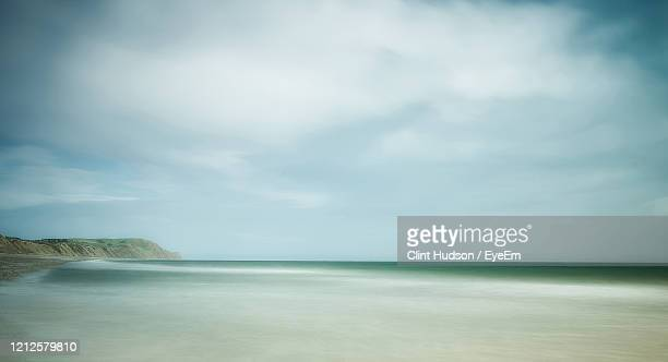 scenic view of sea against sky - isle of man stock pictures, royalty-free photos & images