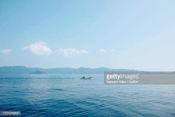 scenic view of sea against sky - horizon over land stock pictures, royalty-free photos & images