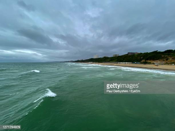 scenic view of sea against sky - bournemouth england stock pictures, royalty-free photos & images
