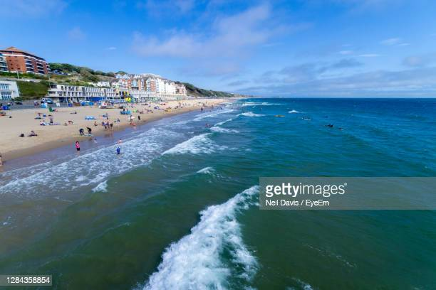 scenic view of sea against sky - beach stock pictures, royalty-free photos & images
