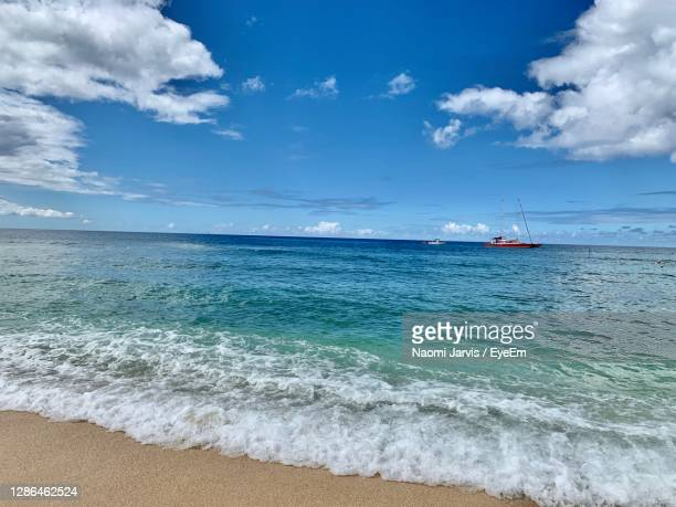 scenic view of sea against sky - naomi jarvis stock pictures, royalty-free photos & images