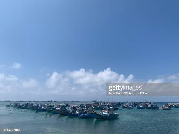 scenic view of sea against sky - neu ストックフォトと画像