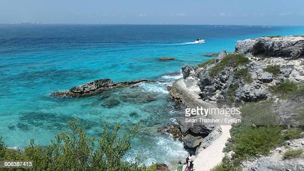 scenic view of sea against sky - isla mujeres stock photos and pictures