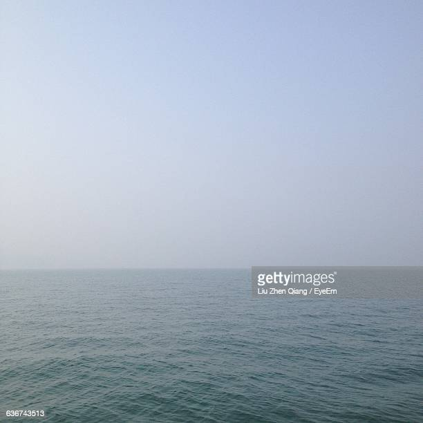 scenic view of sea against sky - liu he stock pictures, royalty-free photos & images