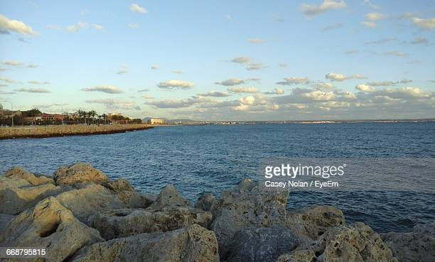 scenic view of sea against sky - casey nolan stock pictures, royalty-free photos & images