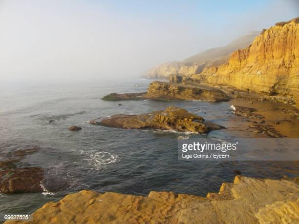 scenic view of sea against sky - liga cerina stock pictures, royalty-free photos & images