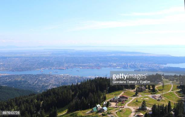 scenic view of sea against sky - grouse mountain stock photos and pictures