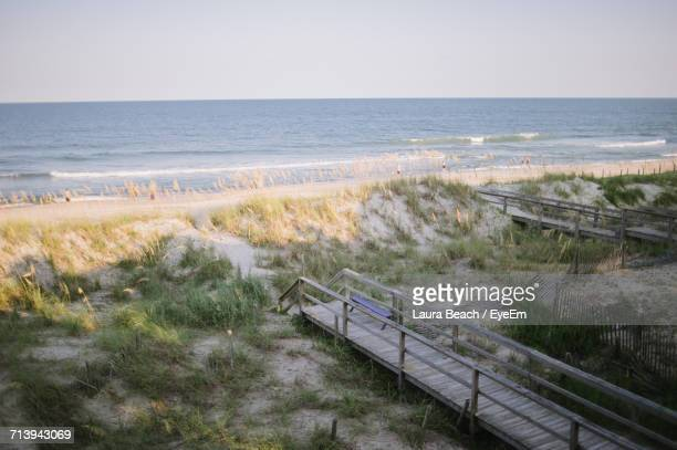 scenic view of sea against sky - wilmington north carolina stock photos and pictures