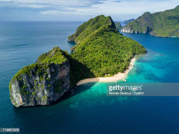 scenic view of sea against sky - el nido stock pictures, royalty-free photos & images