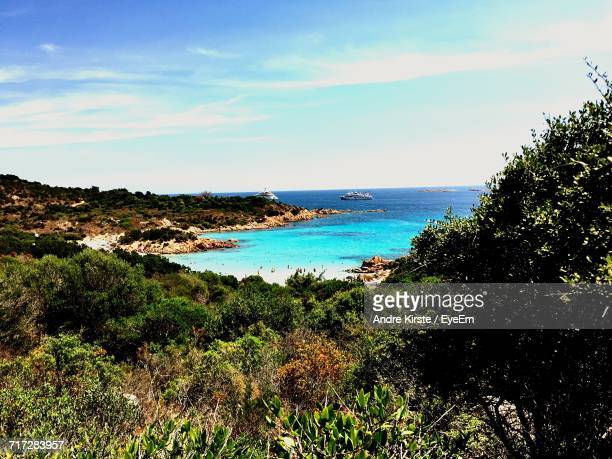 scenic view of sea against sky - costa smeralda stock pictures, royalty-free photos & images