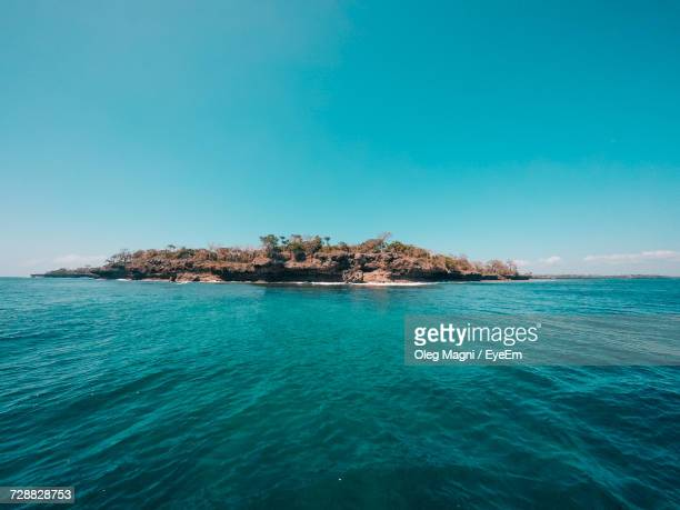 scenic view of sea against sky - mombasa stock photos and pictures