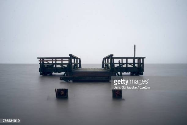 scenic view of sea against sky - husum stock-fotos und bilder