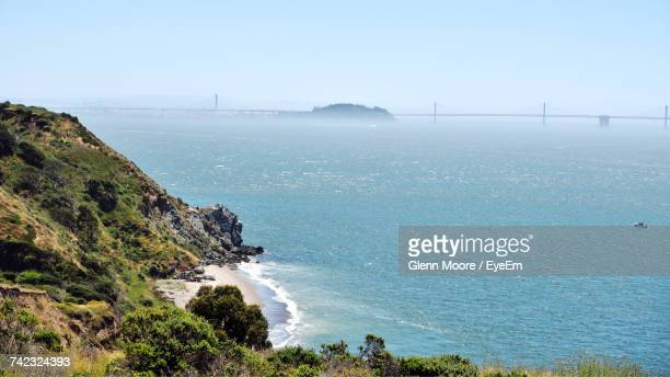 scenic view of sea against sky - angel island stock photos and pictures