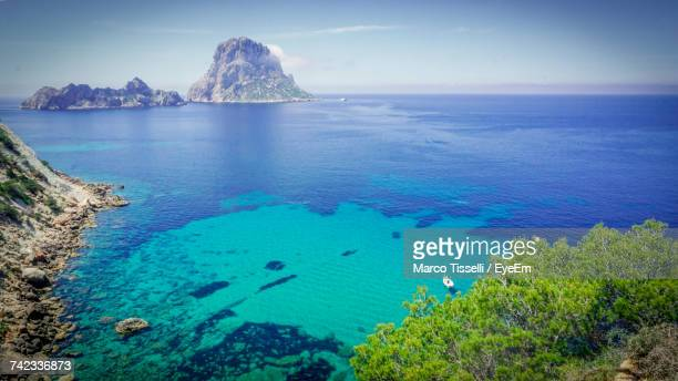 scenic view of sea against sky - insel ibiza stock-fotos und bilder
