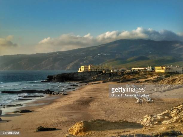 scenic view of sea against sky - cascais stock photos and pictures