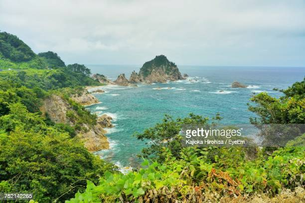scenic view of sea against sky - tottori prefecture stock photos and pictures