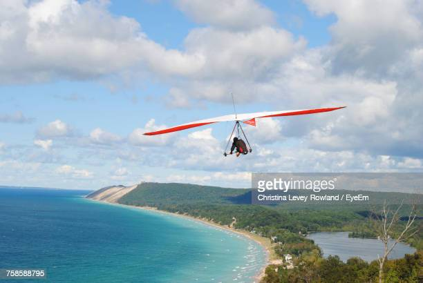 scenic view of sea against sky - gliding stock photos and pictures