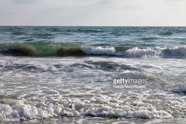 scenic view of sea against sky - muro stock photos and pictures