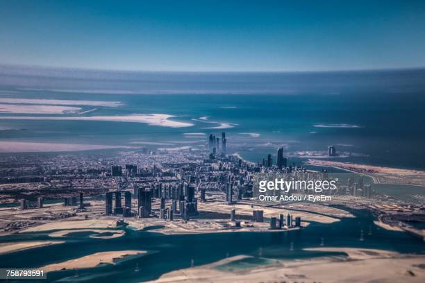 scenic view of sea against sky - abu dhabi stock pictures, royalty-free photos & images