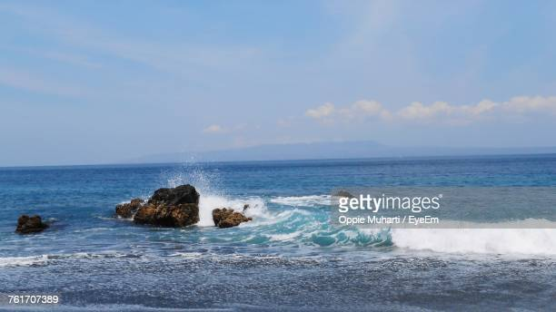 scenic view of sea against sky - oppie muharti stock pictures, royalty-free photos & images