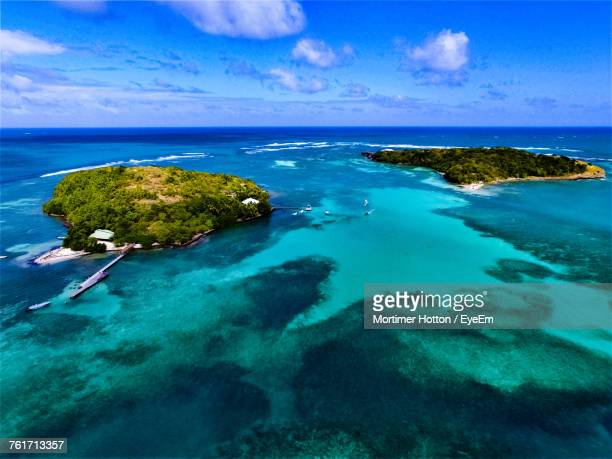 scenic view of sea against sky - martinique stock photos and pictures