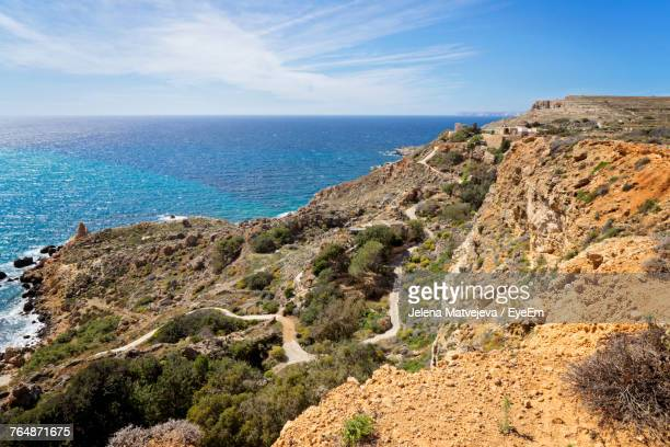 scenic view of sea against sky - maltese islands stock photos and pictures