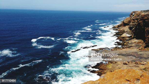 scenic view of sea against sky - mossel bay stock pictures, royalty-free photos & images