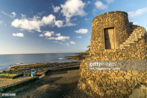 scenic view of sea against sky - arrecife stock photos and pictures