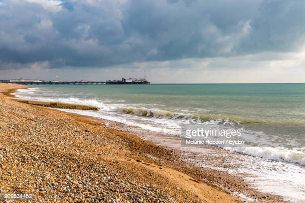 scenic view of sea against sky - brighton beach england stock pictures, royalty-free photos & images