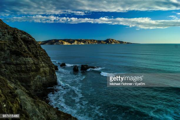 scenic view of sea against sky - gisborne stock photos and pictures