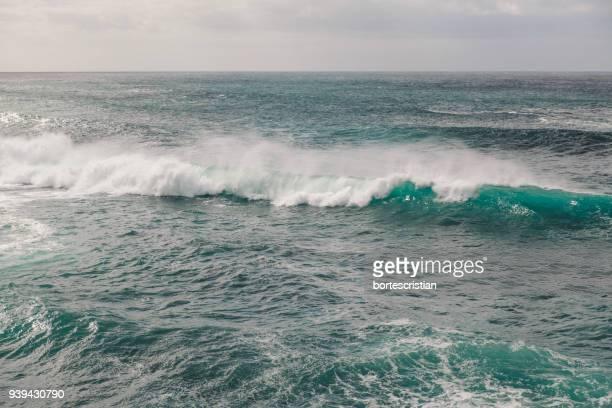 scenic view of sea against sky - bortes photos et images de collection