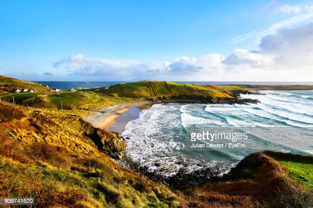 scenic view of sea against sky - county donegal stock photos and pictures