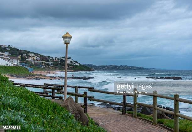 scenic view of sea against sky - durban beach stock photos and pictures
