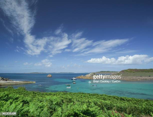 scenic view of sea against sky - isles of scilly stock pictures, royalty-free photos & images