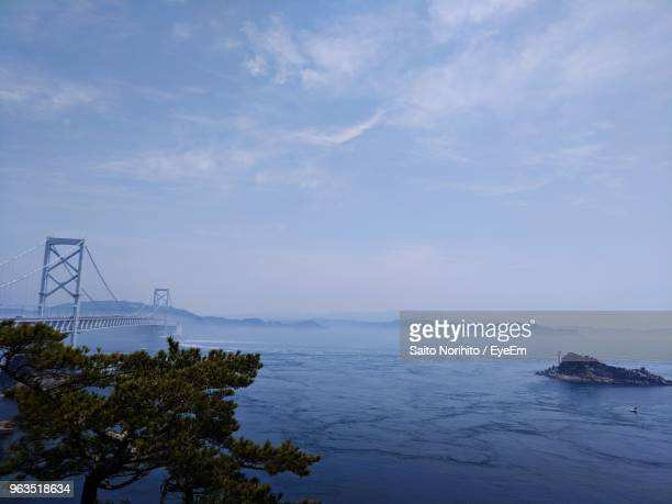 scenic view of sea against sky - naruto stock photos and pictures