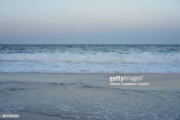 scenic view of sea against sky - adriana duduleanu stock photos and pictures