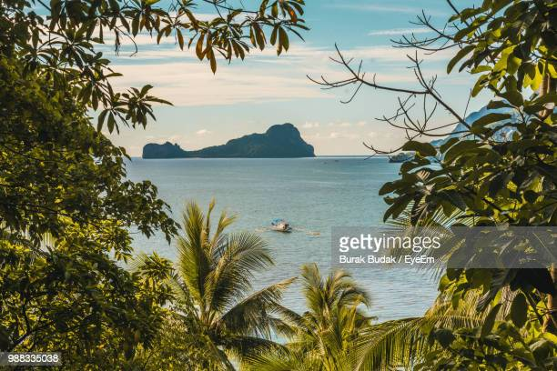 scenic view of sea against sky - palawan island stock pictures, royalty-free photos & images