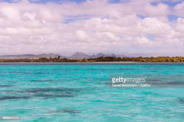 scenic view of sea against sky - port louis stock photos and pictures